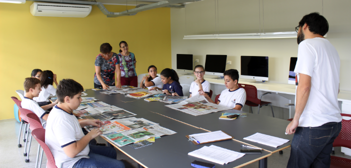 Foto de alunos da EMEF Bartolomeu de Gusmão em oficinal de texto e jornalismo